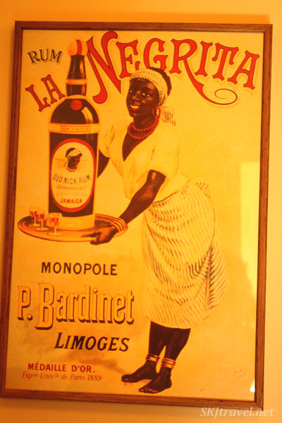 Old advertisement poster for La Negrita rum. photo by Shara Johnson