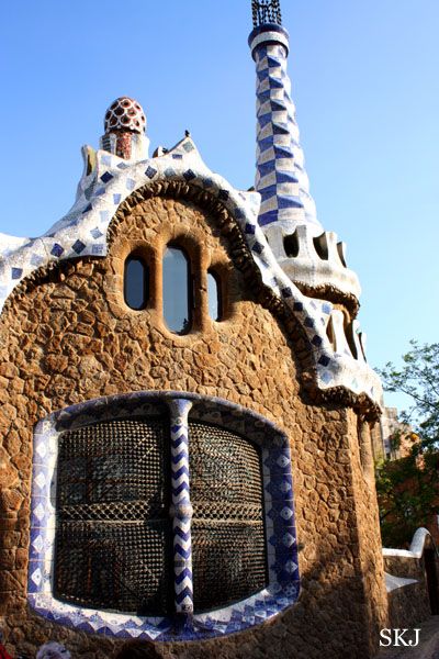 Stone building with blue-tiled window at Parc Guell in Barcelona. photo by Shara Johnson