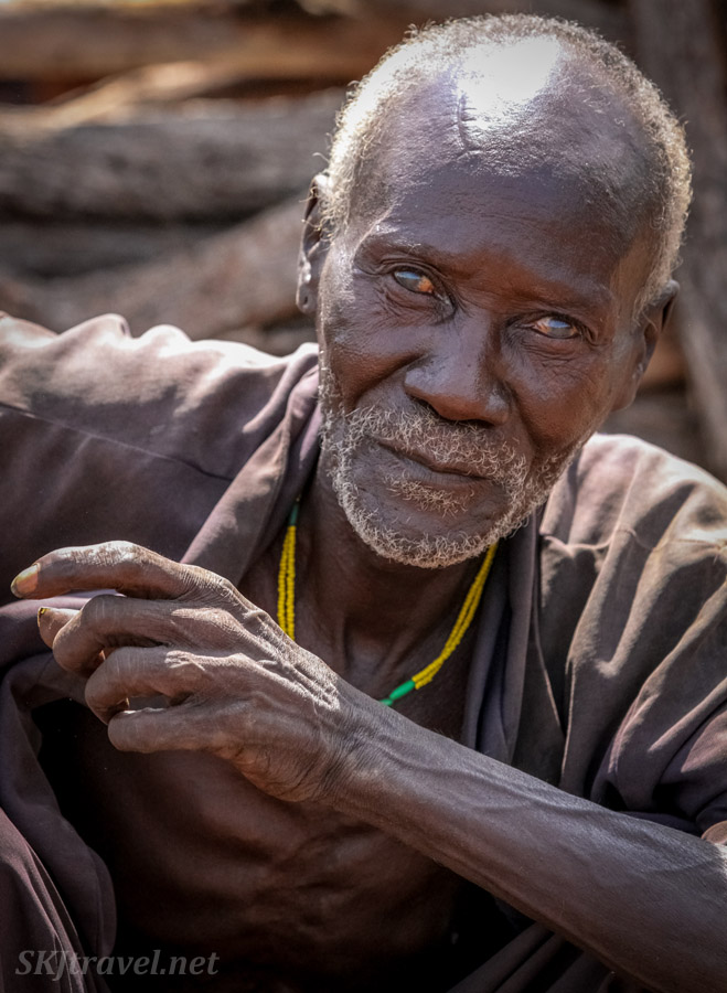 Old Himba man nearly blind with cataracts. Kunene region, Kaokoland, Namibia.