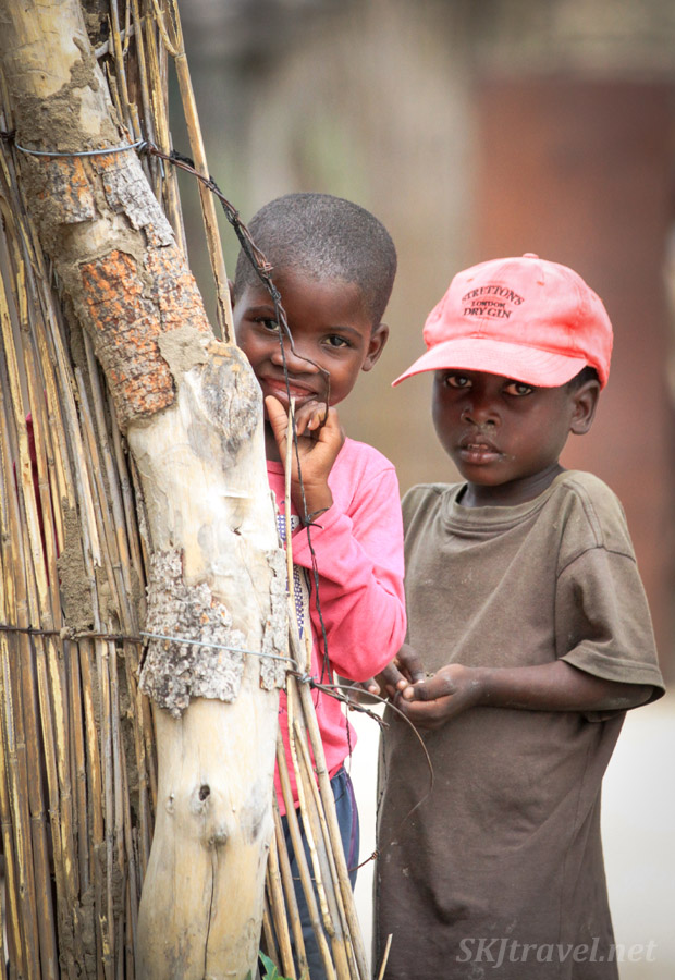 Kids in pink, smiling shyly for the camera. Caprivi Strip, Namibia.