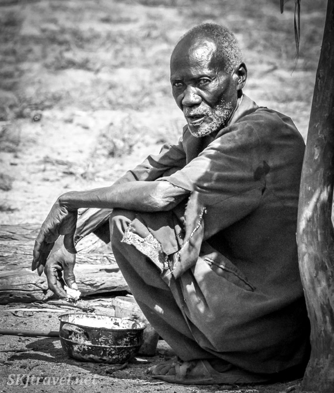 Blind man in Himba village, northern Namibia.