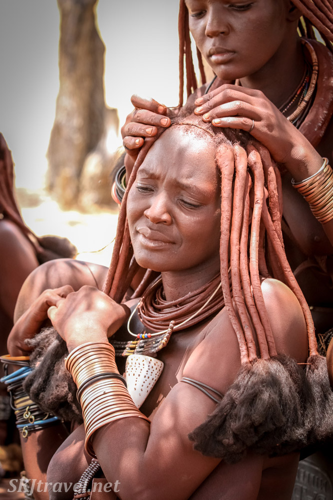 Kaviruru helping maintain her mother's hairstyle. Northern Namibia.