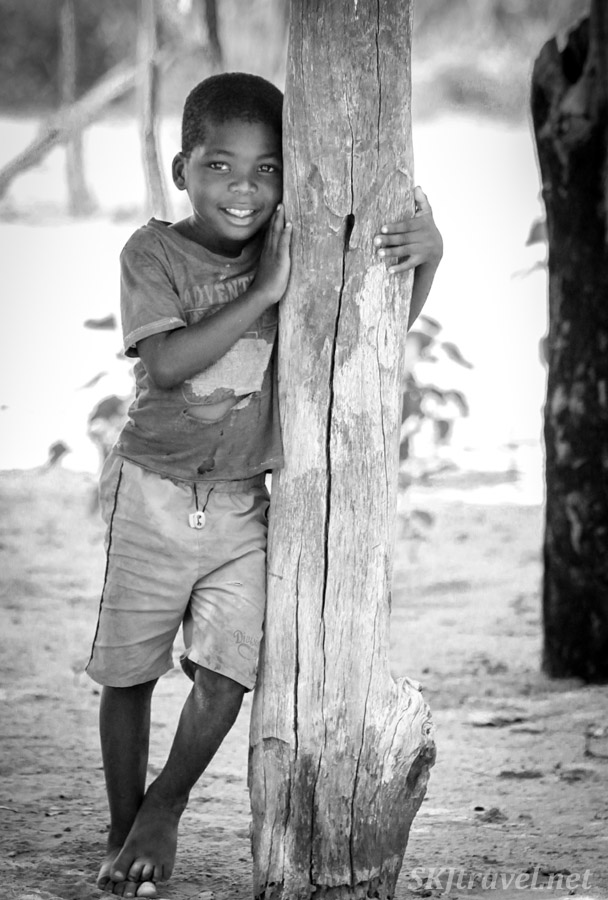 Young boy in the Kavango, shyling posing. Namibia.
