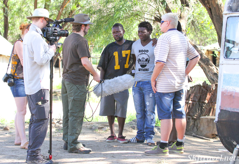 Film crew for The African Witchfinder interviewing Chief Petrus other woodcarvers. Okahandja, Namibia.