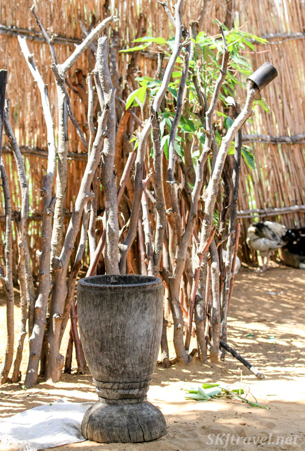 Grinding pestle in a family's courtyard, Kavango region, Namibia.