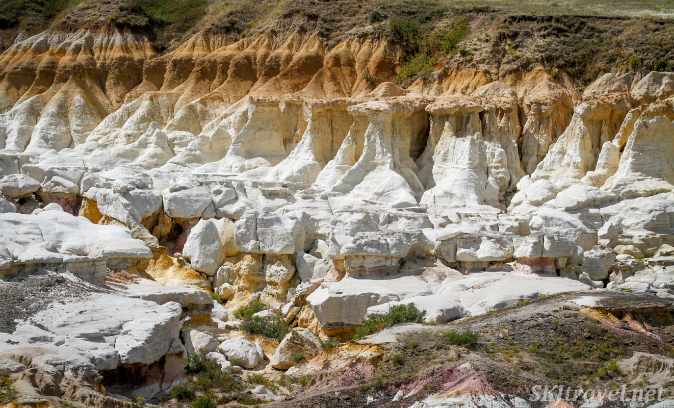 Cliff of white sandstone eroding into pillars, Painted Mines Interpretive Park, Calhan, Colorado.