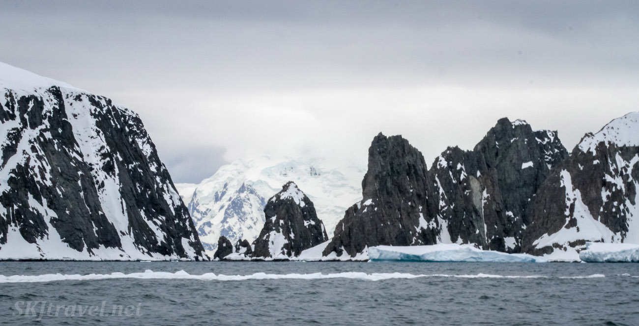 Landscape of black rock faces at Spert Island, Antarctica.