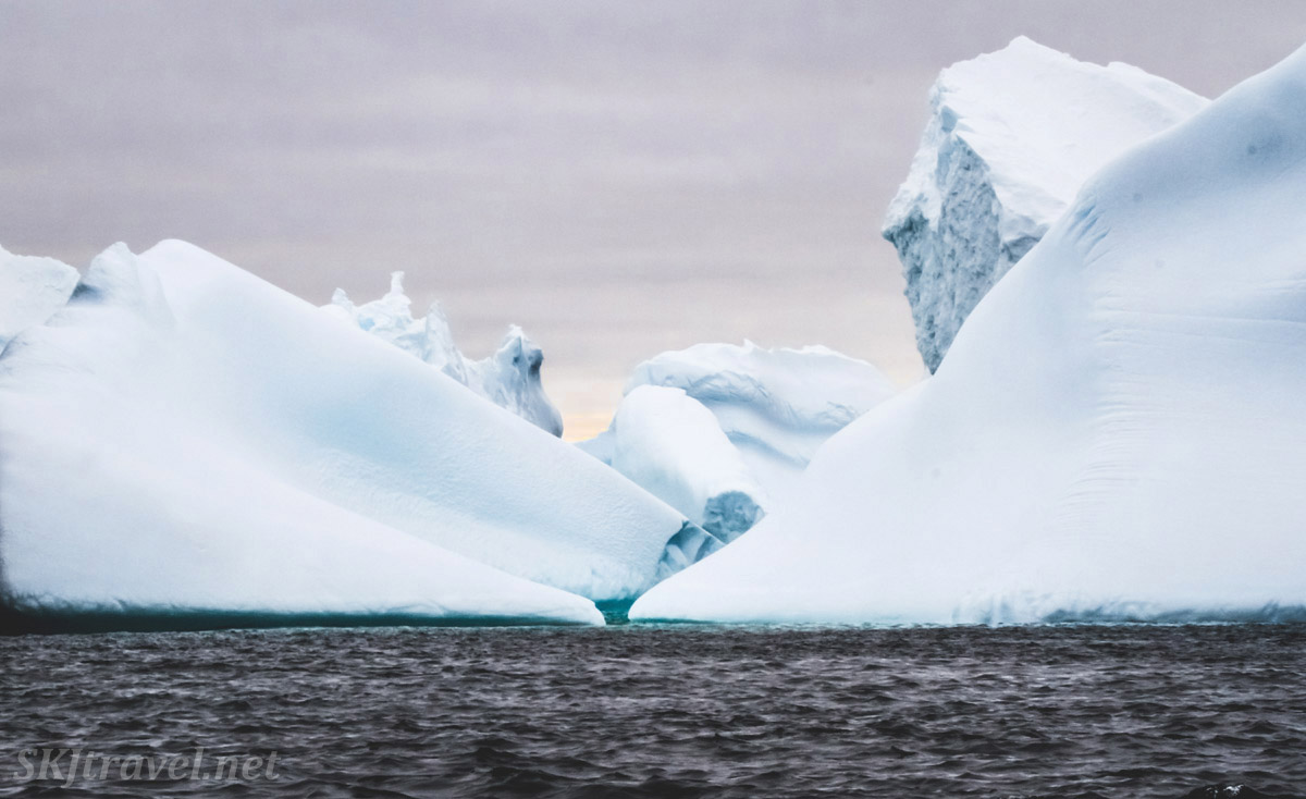 Jumble of icebergs in the waters a Spert Island, Antarctica.