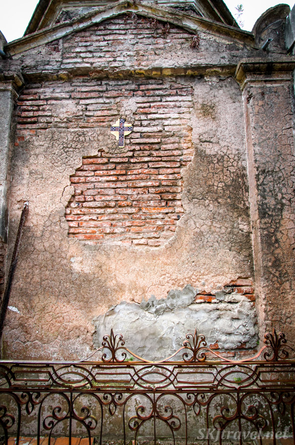 Exposed brick wall of a decaying mausoleum in Recoleta Cemetery, Buenos Aires, Argentina.