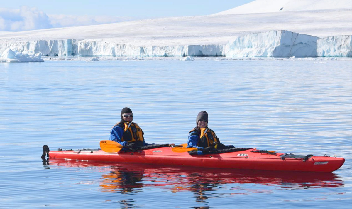 Erik and Shara kayaking in Antarctica!
