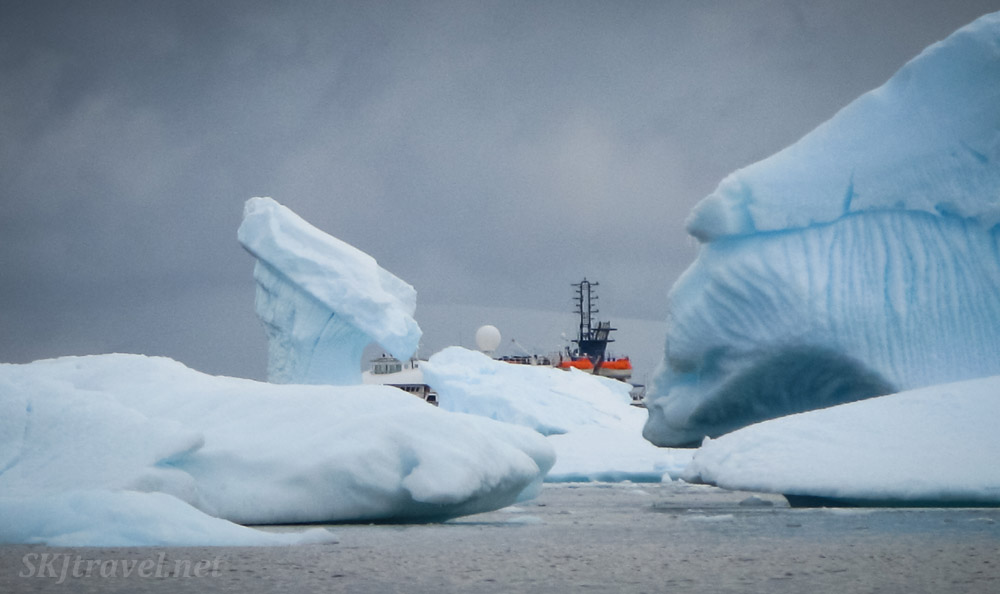 Our ship, Sea Spirit, among the icebergs at Cuverville Island, Antarctica.