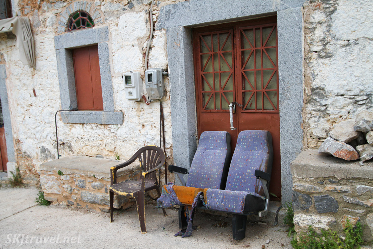 Lounging chairs outside in the alley lend signs of life in the medieval labyrinth of streets in the mastic Mesta village, Chios Island, Greece.