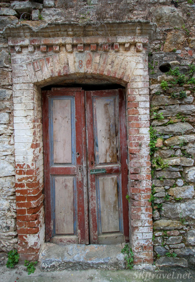 Abandoned doorway framed in bricks in the medieval labyrinth of streets in the mastic Mesta village, Chios Island, Greece.