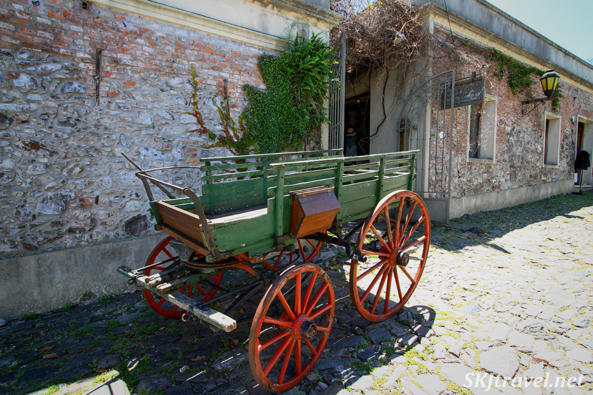Restored wagon on display on a cobblestone street in Colonia del Sacramento, Uruguay.