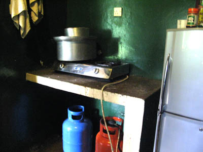 Gas burner and porridge cooking pot inside the kitchen of the chimp house. UWEC Uganda.