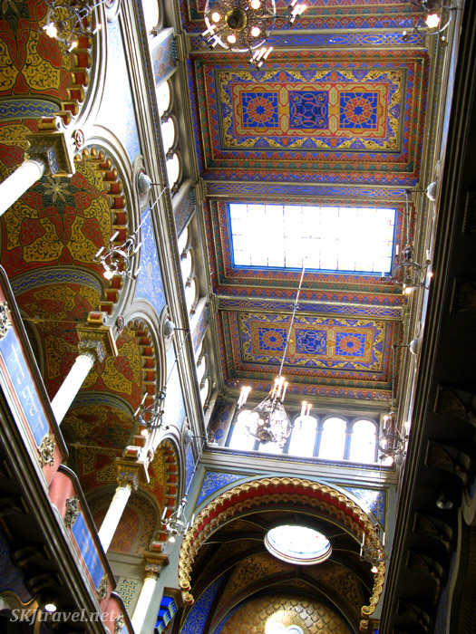 Brightly painting ceilings red, blue, yellow. Synagogue in Jewish Quarter, Prague.