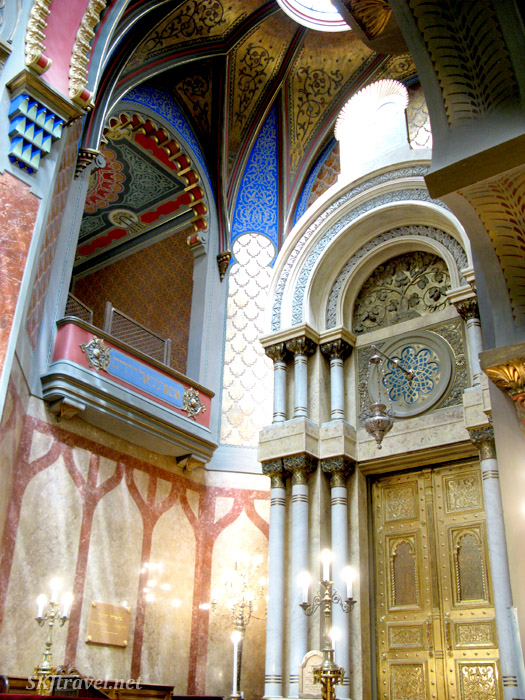 Brightly painting ceilings and walls red, blue, yellow. Interior of New Synagogue in the Jewish Quarter, Prague.
