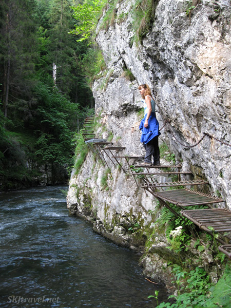 Metal grates bolted into the rocks above the river serve as the trail. Slovensky Raj national park, Slovakia.