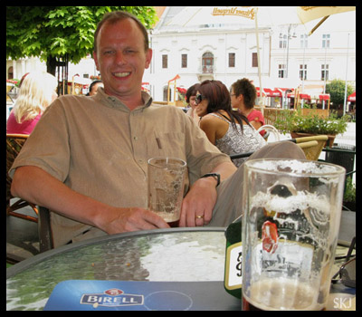 man witting at cafe with beer