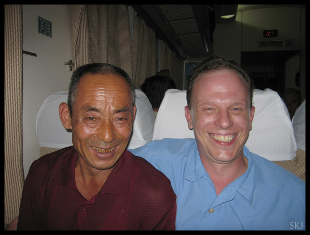 peasant man and westerner on a Train in China