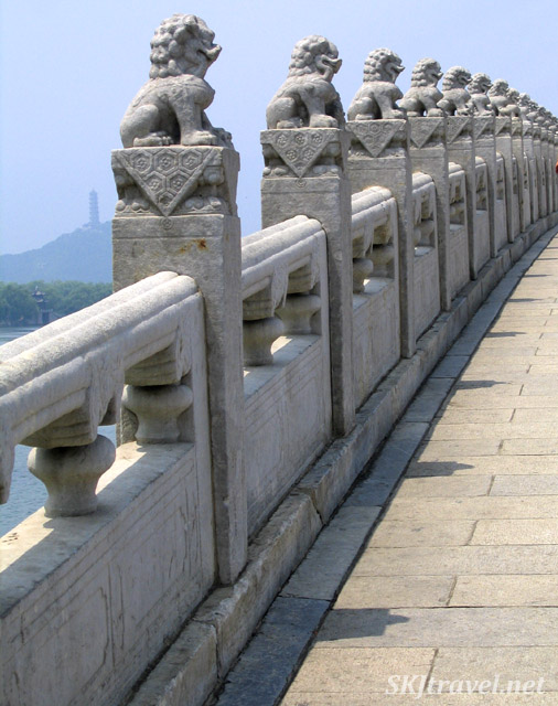 Stone lions accompany you across the 17-Arch Bridge, Summer Palace, China.