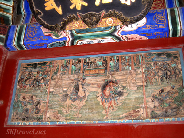 Looks like some kind of sparring tournament with men on horses trying to spear each other while the crowd watches ... the Long Corridor, Summer Palace, China.