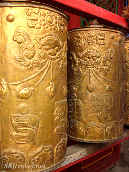 golden cylinders with designs