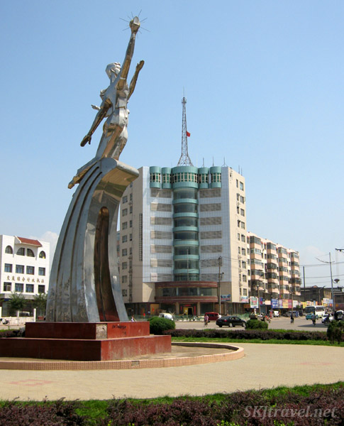 sculpture and modern building