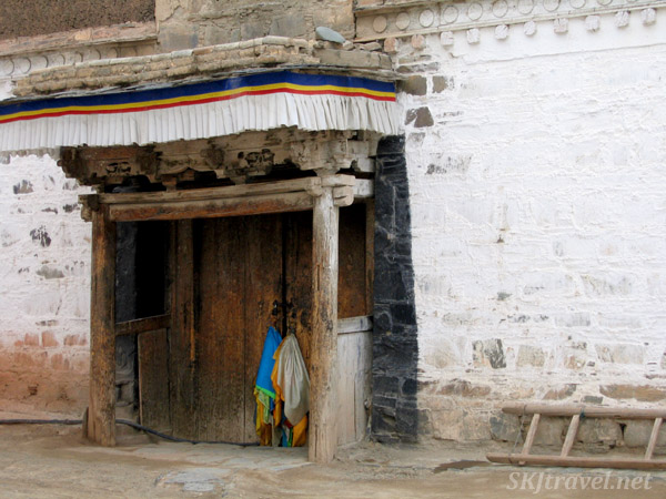 Humble entrance to a building in the Labrang Monastery complex. Xiahe, China.