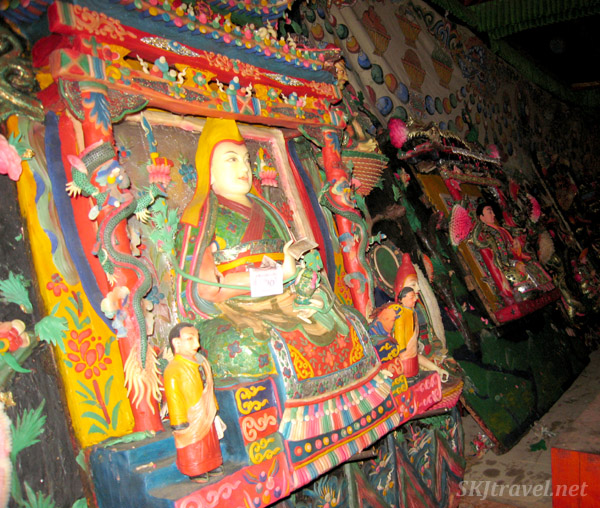 Yak butter sculpture of very colorful detailed scenes including people, animals and designs. Labrang Monastery, Xiahe, China.