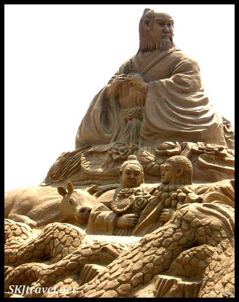 sand sculputre of people