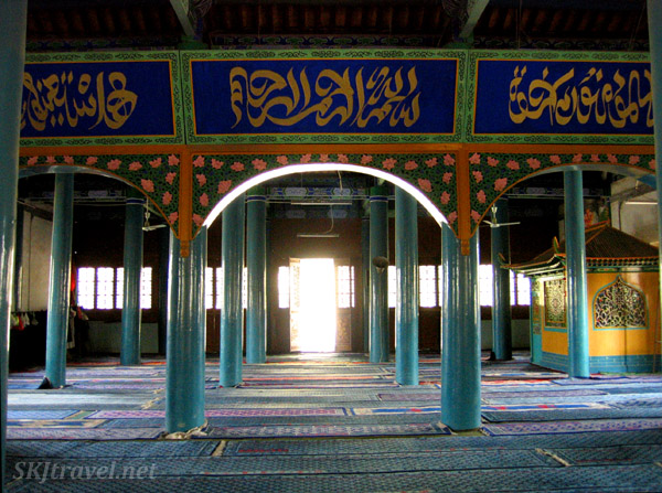 pillars inside mosque looking toward light in open door