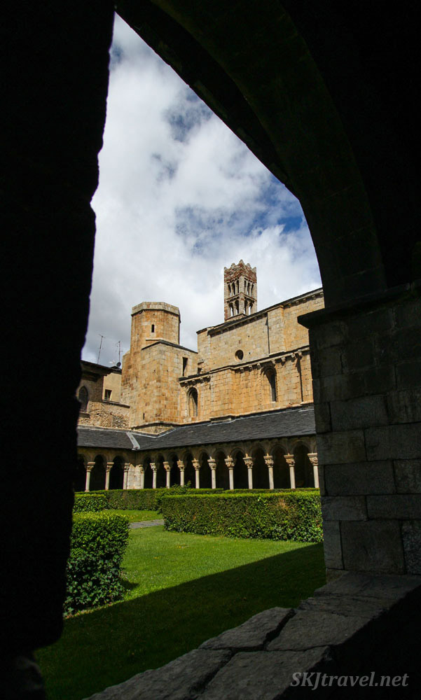 Looking through pillars into the inner courtyard at the abbey in the cathedral of la Seu d'Urgell, Spain.