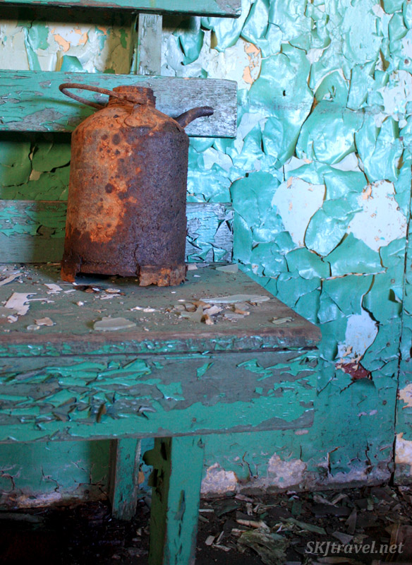 Rusting can on bright green bench. Gilman, Colorado.