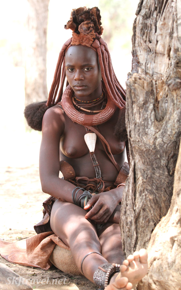 Young married Himba woman near Epupa Falls, Namibia.