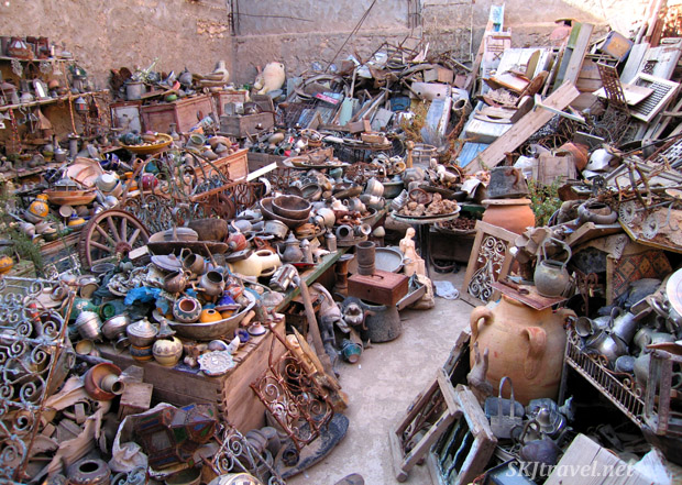 Junk shop with piles of pots, bowls, lamps, teapots, keys, dressers, much more in El Djem, Tunisia. Photo by Shara Johnson