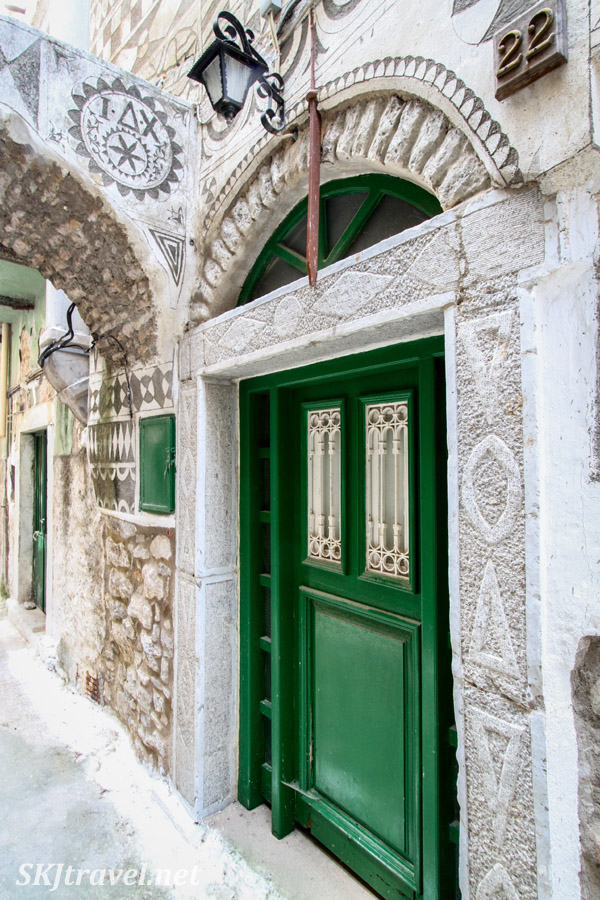 Green door along the cobblestone streets of the old quarter city center of Pyrgi, Chios Island, Greece.