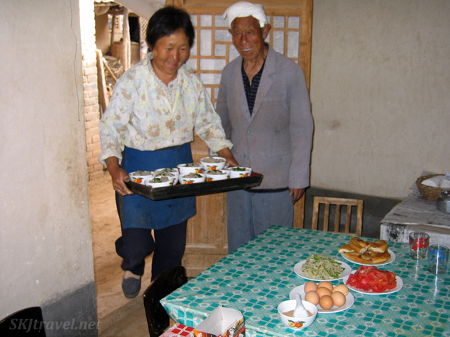 Eldest sister bringing in more bowls of food for us. Dang Jiashan village, Shaanxi Province, China.