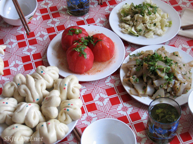 Breads, tomatoes, potato noodles and cabbage ... part of our meal in the rural village, Dang Jiashan, Shaanxi Province, China.