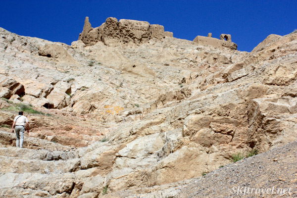 Climbing the rocky hill to Atashgah (Marbin fortress) outside Isfahan, Iran.