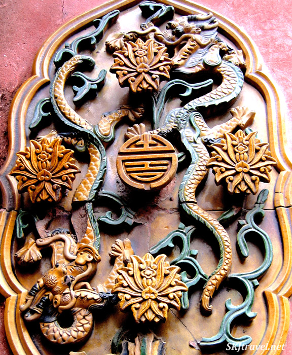 Detail of tilework inside the Forbidden City, Beijing. Common motif of dragons.