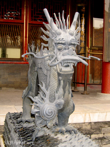 Stone dragon outside one of the buildings in the Inner Courtyard of the Forbidden City. Beijing.