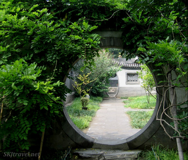 Round portal leading to oval portal in a succession of courtyards inside Prince Gong's Mansion, Beijing.