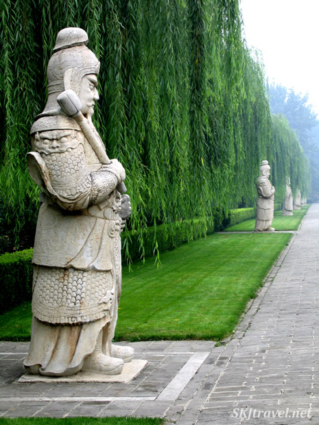 Stone statues of military officers line the Sacred Way, or Spirit Way, at the Ming Tombs outside Beijing, China.