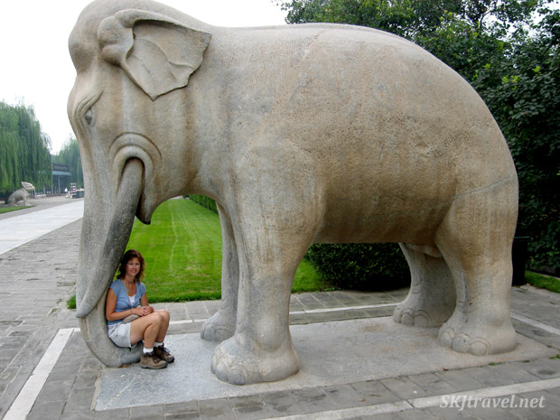 Shara nestled in an elephant's trunk on the Spirit Way, or Sacred Way, at the Ming Tombs outside Beijing, China.