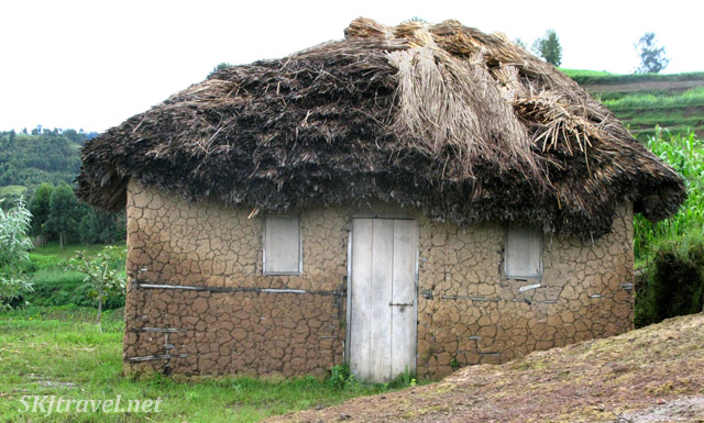 Typical thatched mud hut along the hillside of Lake Bunyoni, Uganda.