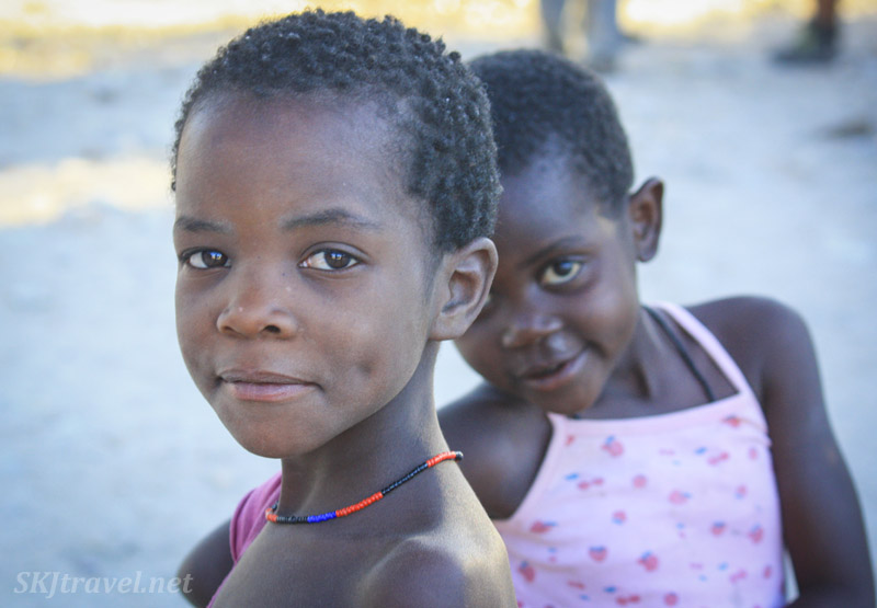 "Two young Himba girls in a ""modern"" village in Kaokoland, Namibia."