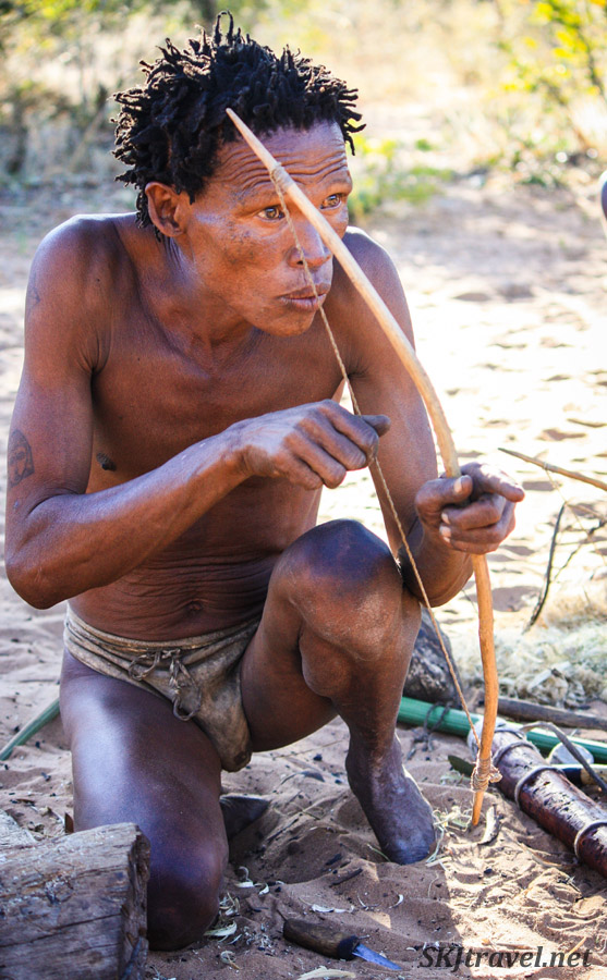 San man demonstrating the use of a bow at the Ju/'Hoansi-San Living Museum near Grashoek, Namibia.
