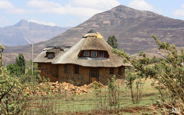 Brick rondeval with thatched roof. Lesotho.