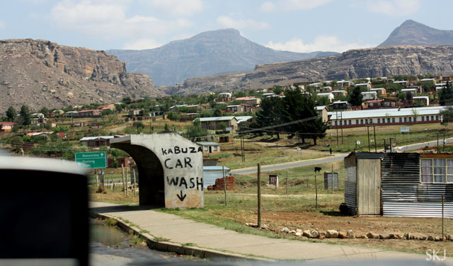 "cement shelter with ""car wash"" painted on it. Lesotho"